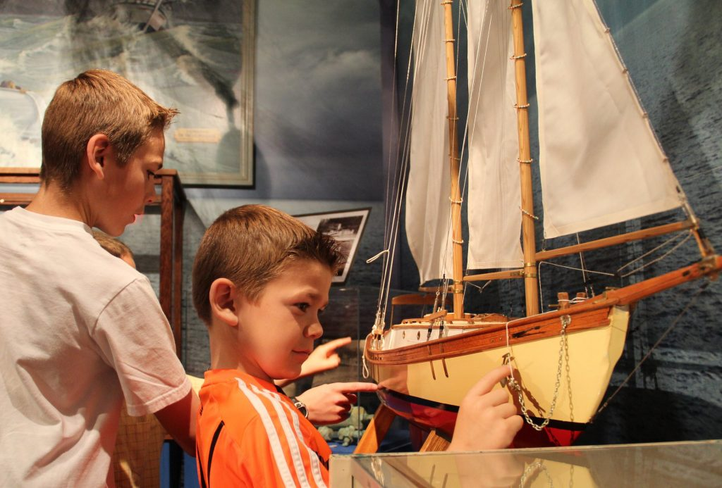 Child looking at model ship at Sidney Museum